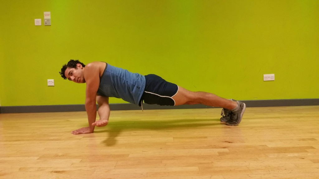 Hand-to-forearm dynamic plank